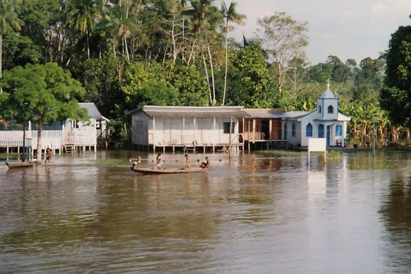 Small church, houses and dugout canoe on the Amazon | Amazon boat trip | Brazil