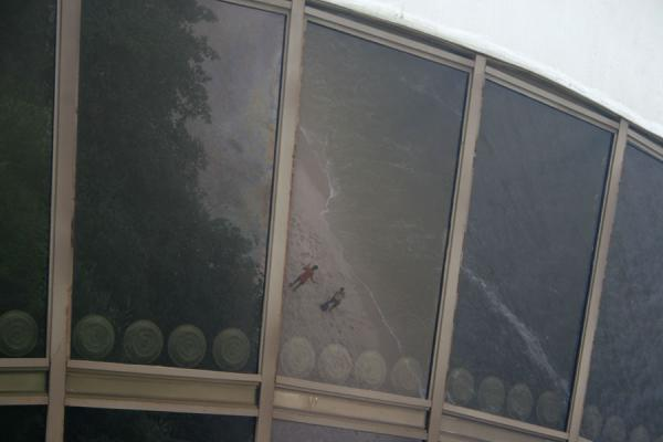 Beach reflected in the windows of the MAC, Niteroi | MAC Niemeyer Museum | Brazil