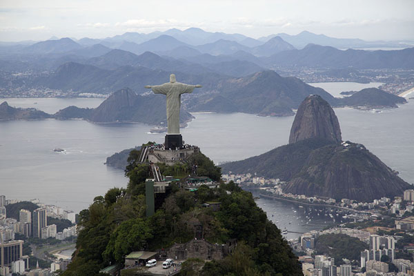 Aerial view of Cristo Redentor, with Sugarloaf mountain and Guanabara Bay in the background | Rio from the sky | Brazil