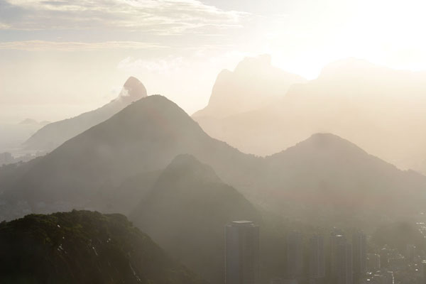Hazy afternoon light over the granite mountains of Rio de Janeiro | Pan de Azucar | Brazil