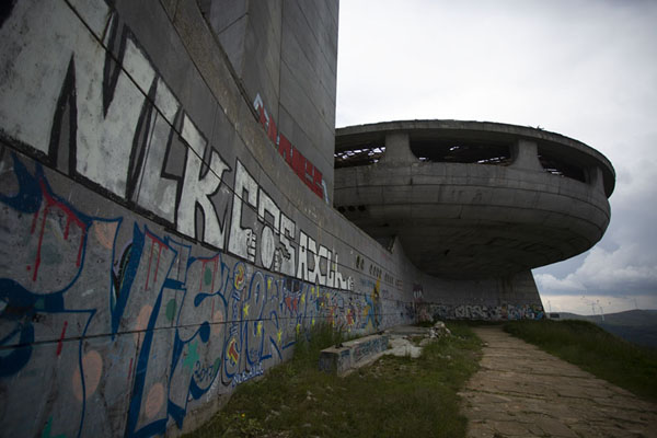Graffiti on the grey walls of the monument | Buzludzha monument | Bulgaria