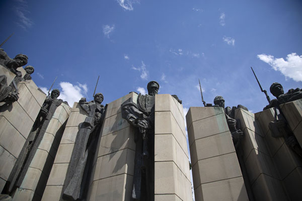 Looking up the monument with a Russian officer flanked by 6 Bulgarian volunteer fighters | Defenders of Stara Zagora monument | Bulgaria