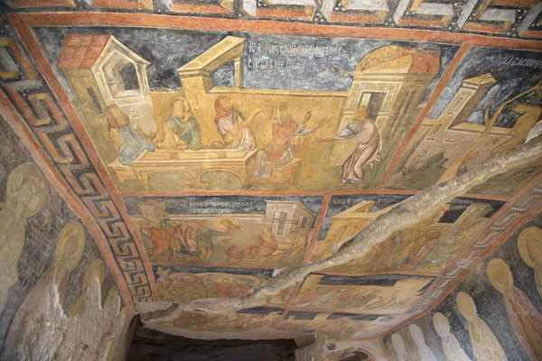 Looking up at the well-preserved frescoes on the ceiling of the Holy Virgin rock church | Ivanovo rock hewn church | Bulgaria