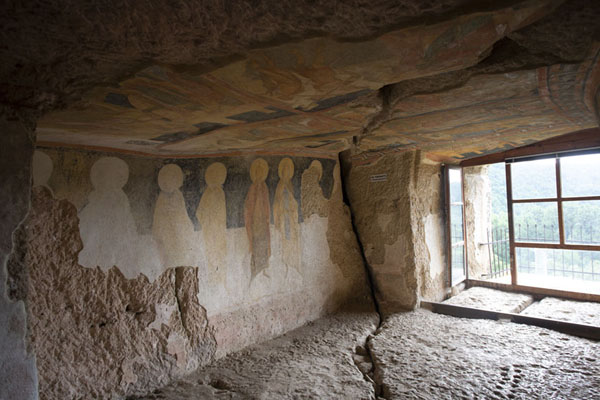 Looking towards the balcony with frescoes on the wall | Ivanovo rock hewn church | Bulgaria