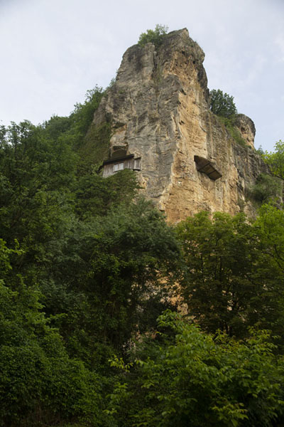 Foto van Rock formation with the entrance of the Holy Virgin rock church visible halfway up - Bulgarije - Europa