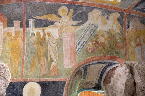 Picture of Frescoes covering a wall and arch inside the Holy Virgin rock church