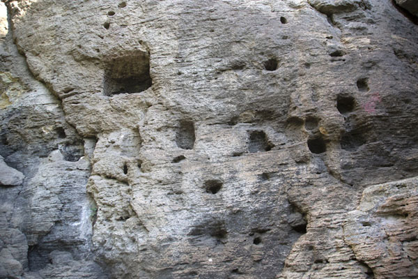 Foto van Cells in the face of the rock near the Big Cave, part of the cave monasteryMadara - Bulgarije