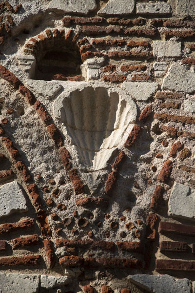 Foto van Detail with shell in the facade of the church of Saint John AliturgetosNesebar - Bulgarije