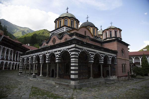 The Rila mostery with snowy mountains in the background | Rila Monastery | Bulgaria