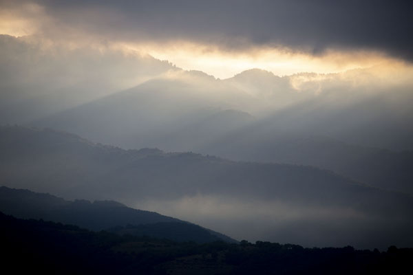 Early morning sunlight filtering through the clouds near Rozhen Monastery | Rozhen Monastery | Bulgaria