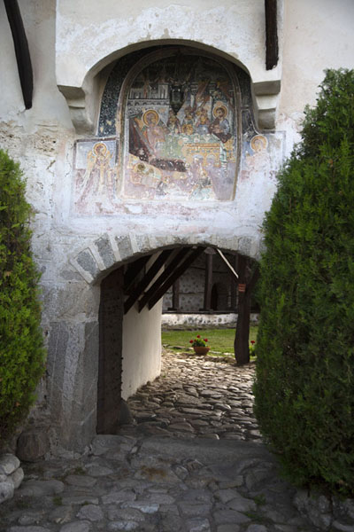 Entrance of Rozhen Monastery with half-faded fresco above the gate | Rozhen Monastery | Bulgaria