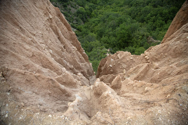 Looking down the badlands of the sandstone pyramids | Rozhen Monastery | Bulgaria