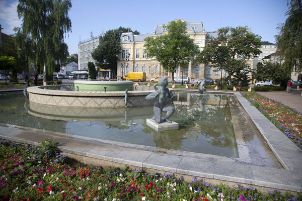 Fountain with the Ruse Regional museum in the background | Ruse | Bulgaria