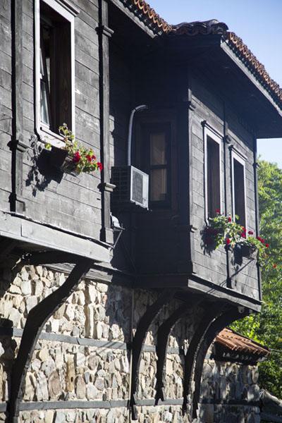 Foto van Wooden upper floor jutting out of a traditional house in SozopolSozopol - Bulgarije