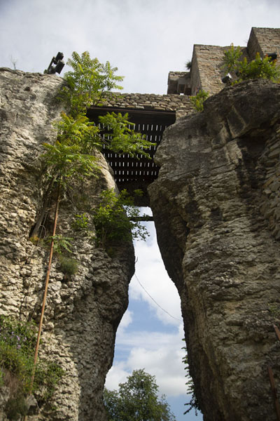 Looking up the bridge over a crack in the rocks at the main entrance | Tsarevets Fortress | Bulgaria