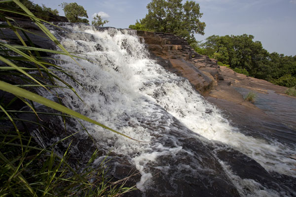 Water rushing down one of the more impressive falls at Karfiguela | Karfiguela waterfalls | Burkina Faso