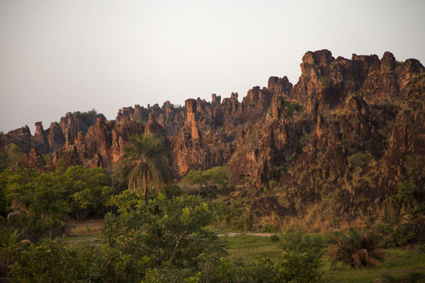 Chain of orange vertical rocks at Sindou seen at sunrise | Sindou Peaks | Burkina Faso