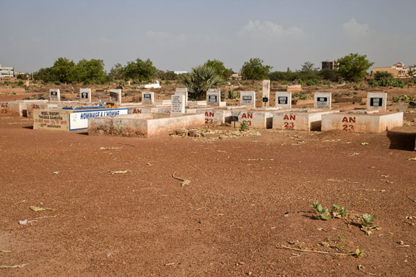 Picture of Row of tombs for the comrades of Thomas Sankara, with the former president in the middle - Burkina Faso - Africa