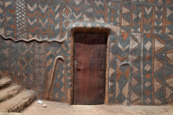 Door with sculpted canes in a painted house of Tiébélé | Tiébélé painted houses | Burkina Faso