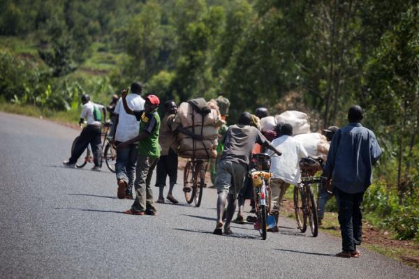 Group of cyclists pushing their bikes up the mountain | Burundi cyclists | Burundi