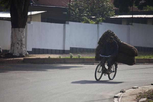 Picture of Burundi cyclists (Burundi): Cyclist with heavy load racing into Bujumbura
