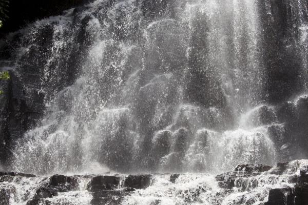 Picture of Curtain of water coming down a rocky cliff at the Chutes de la Karera