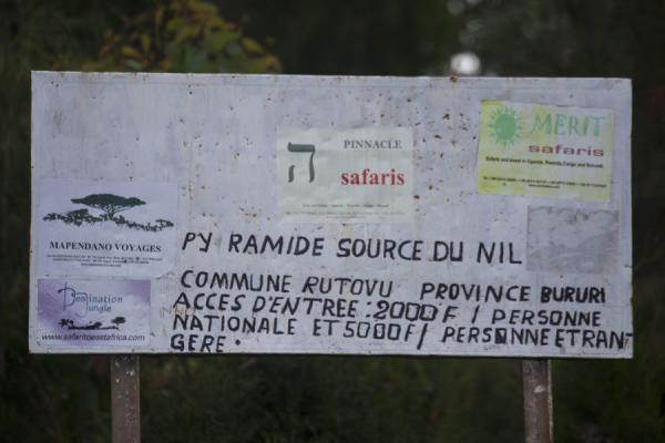 Foto di Small sign at the entrance of the source of the NileSource du Nil - Burundi