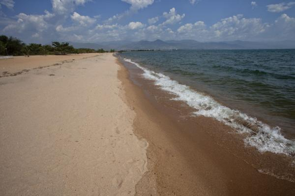 Looking east along the sandy beach of Saga with the mountains of Burundi in the background | Saga Beach | Burundi
