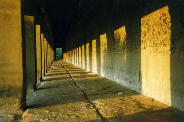 Picture of Angkor Wat temple: corridor with sun shining inside