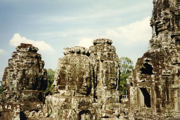 Picture of Angkor Wat (Cambodia): Faces of Buddha sculpted from the stone of a temple at Angkor Wat
