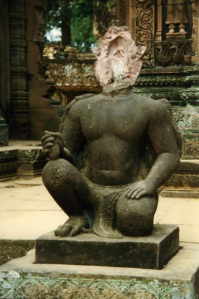 Picture of Angkor Wat (Cambodia): Face of statue of Angkor Wat blown away by gunfire