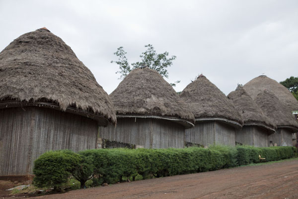 Row of houses where representatives of the provinces of Bandjoun gather | Bandjoun chefferie | Cameroon
