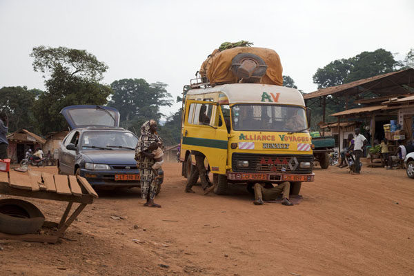 Mechanic under our van on one of the many mechanical stops | Bertoua to Libongo | Cameroun
