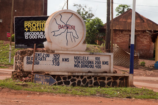 Picture of Bertoua to Libongo (Cameroon): Sign indicating the distances to cities at a roundabout in Batouri