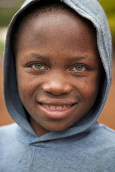 Green eyes in a young face in Nkombe | Cameroonian people | Cameroon