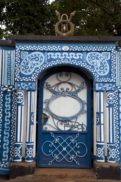 Picture of Entrance to a secluded section of the palace with bright blue and white coloursFoumban - Cameroon
