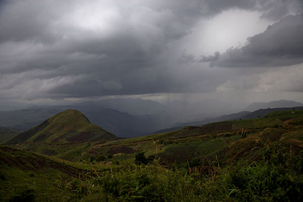 Threatening sky over the mountains of the Ring Road | Grassfields Ring Road | Cameroon