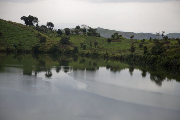 The tranquil waters of Lake Wum reflecting the landscape | Grassfields Ring Road | Cameroon