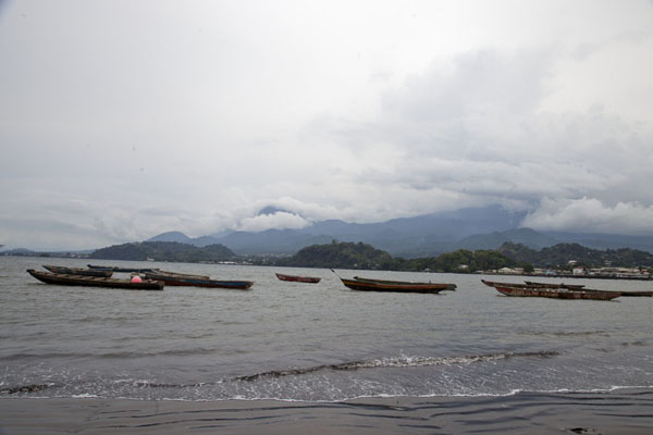 Picture of Pirogues in the bay of Limbe with Mount Cameroon in the background - Cameroon - Africa