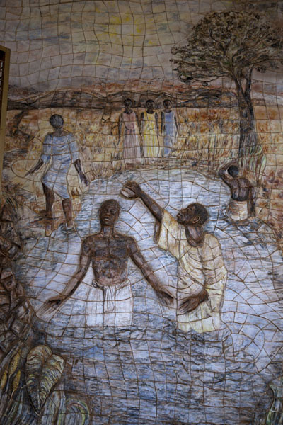 Picture of Yaoundé basilica (Cameroon): Scene on the outside wall of the basilica of Yaoundé