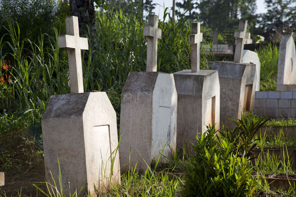 Row of tombs in the small cemetery near the basilica of Yaoundé | Yaoundé basilica | Cameroon