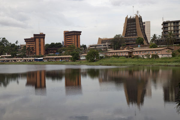 Modern city buildings reflected in the Municipal lake | Municipal Lake | Cameroon