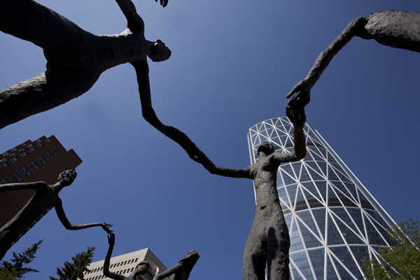Picture of Calgary Street Art (Canada): Brotherhood of Mankind, by Mario Armengol: a collection of very tall, slim figures