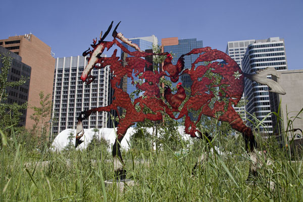Picture of Do Re Me Fa Sol La Si Do - a row of life-size horses running through CalgaryCalgary - Canada
