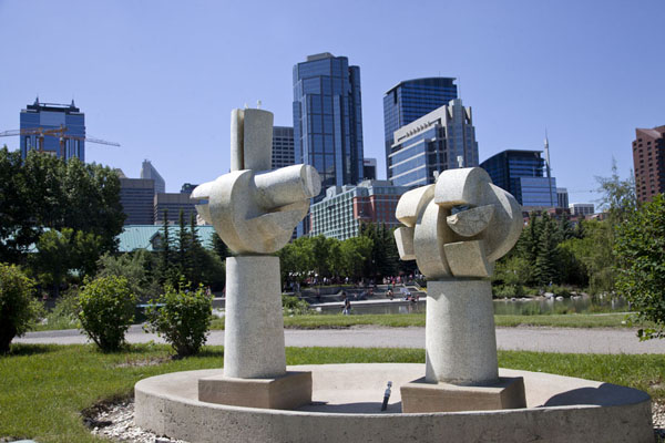 Picture of Calgary Street Art (Canada): One of the sculptures on Prince's Island Park: Cracked Pot Foundations, with the skyline of Calgary in the background