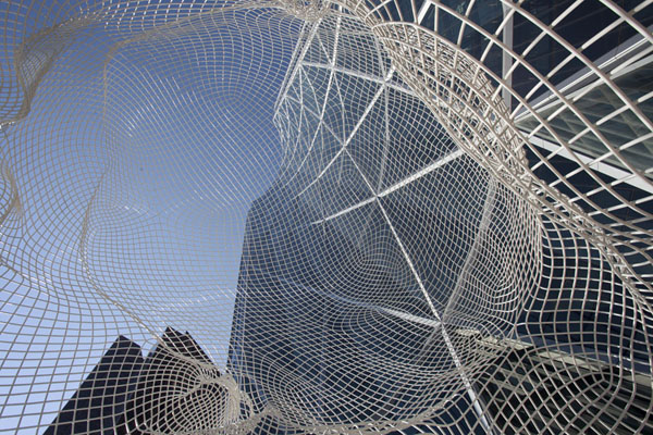 Picture of Calgary Street Art (Canada): Looking up the Bow through the head of Wonderland, by Jaume Plensa