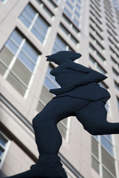 Picture of Calgary Street Art (Canada): Human figures sculpted on the Weather Vanes installation