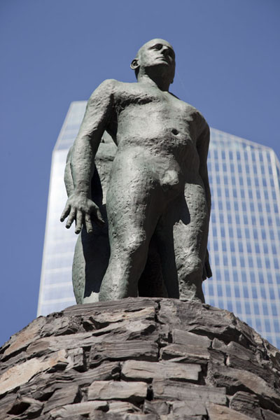 Picture of Calgary Street Art (Canada): Between the Earth and the Sky - Measuring the Immeasurable - installation of which these two statues are the highest part