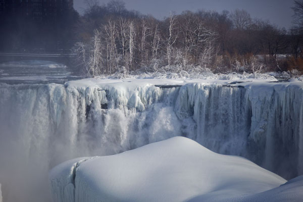 Picture of Frozen Niagara Falls (Canada): Bridal Veil Falls with ice-covered boulders and trees