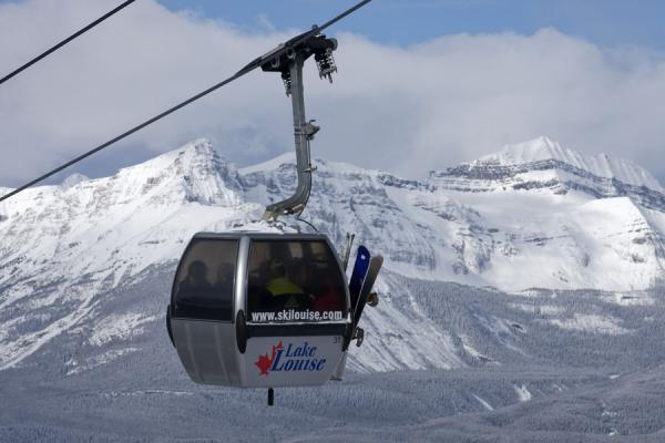 Picture of Lake Louise skiing (Canada): Skiers going up by Grizzly Gondola in the Lake Louise ski area